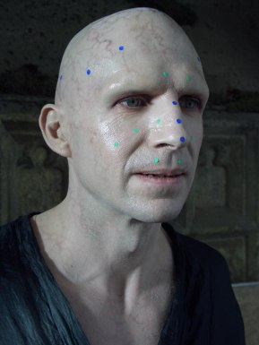 Ralph Fiennes in make up and tracking dots
